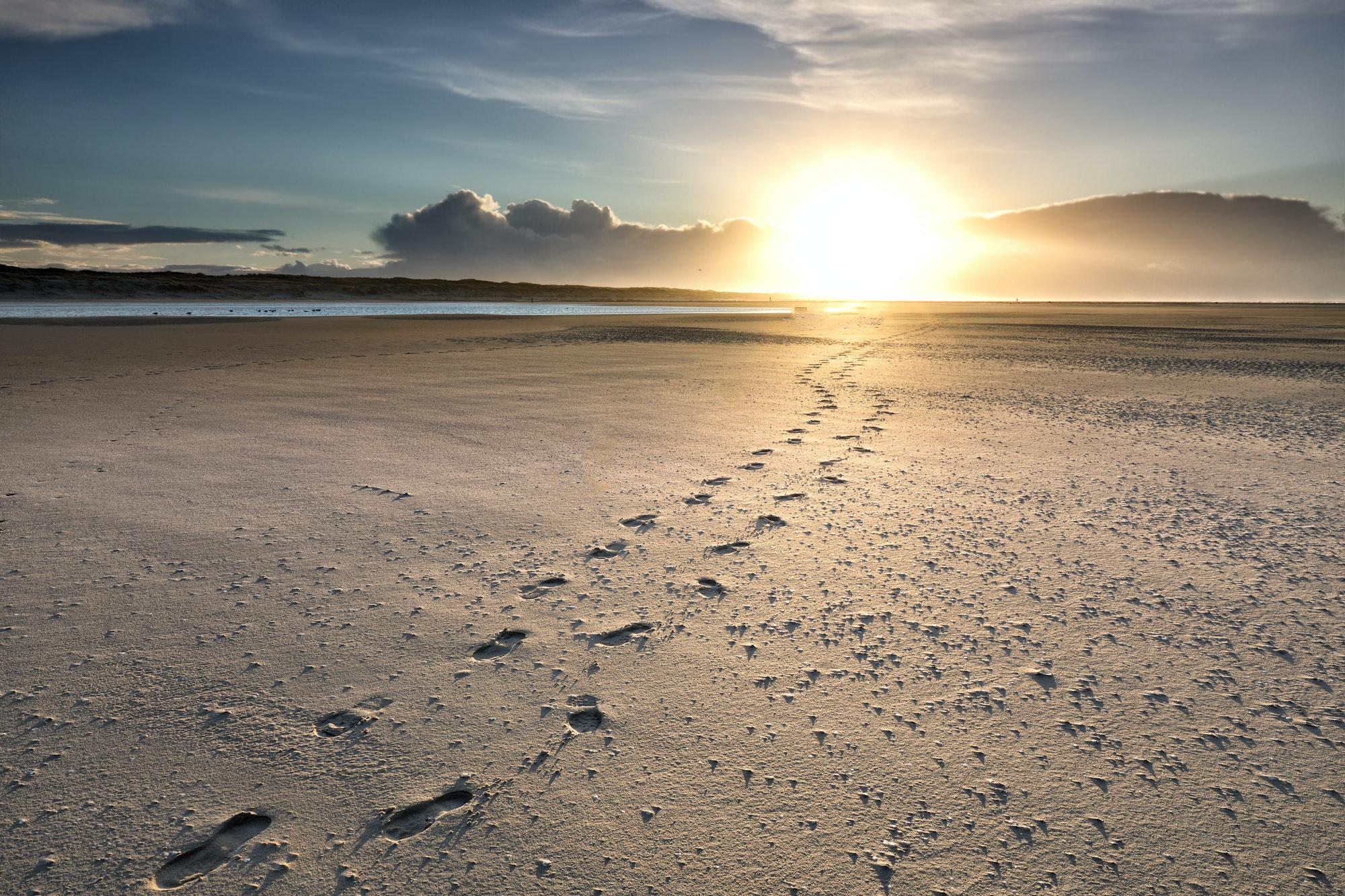track path on sand beach to sun